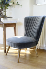 Close up of the legs of our Cotswold Grey Pearson velvet occasional chair.