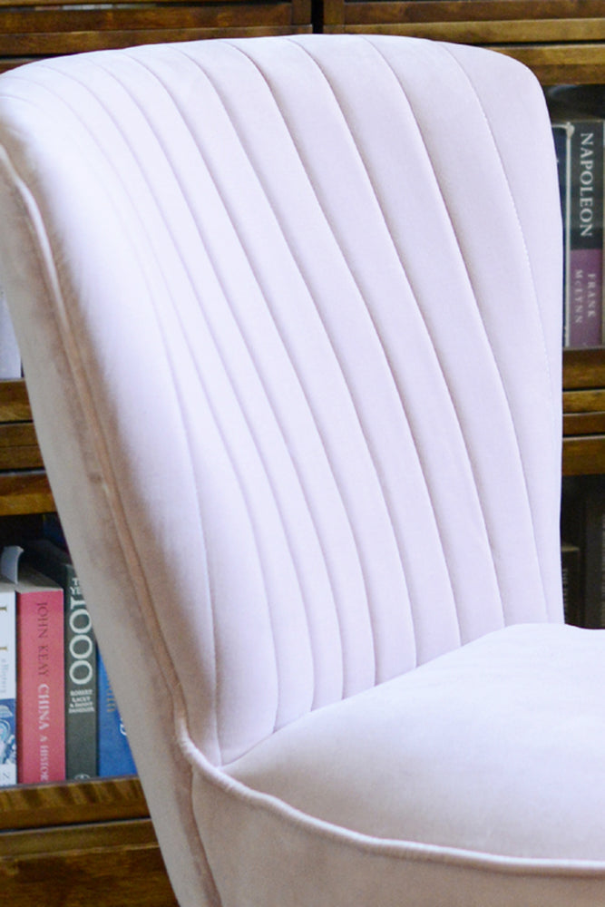 Close up of the blush pink Cotswold Grey Pearson velvet chair