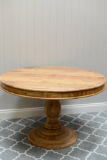 The round base table stood on its own against a grey background