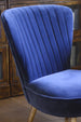 The sumptuous navy blue fabric covering deep luxurious padding on the Cotswold Grey Pearson Chair.