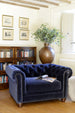 Cotswold Grey navy blue chesterfield style tub chair in room setting.