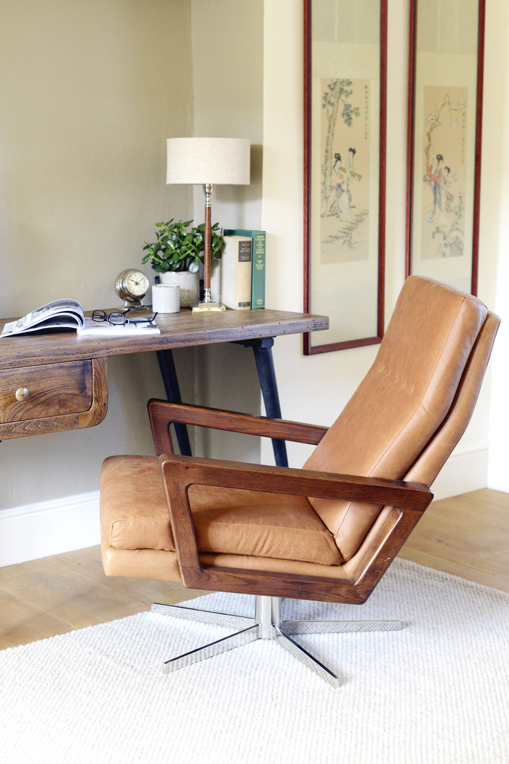 The brown leather Bateman swivel chair in an office.