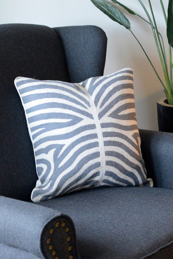 Grey and white zebra patterned cushion sat on a chair