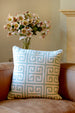 Nishat cushion sat on a brown James leather sofa