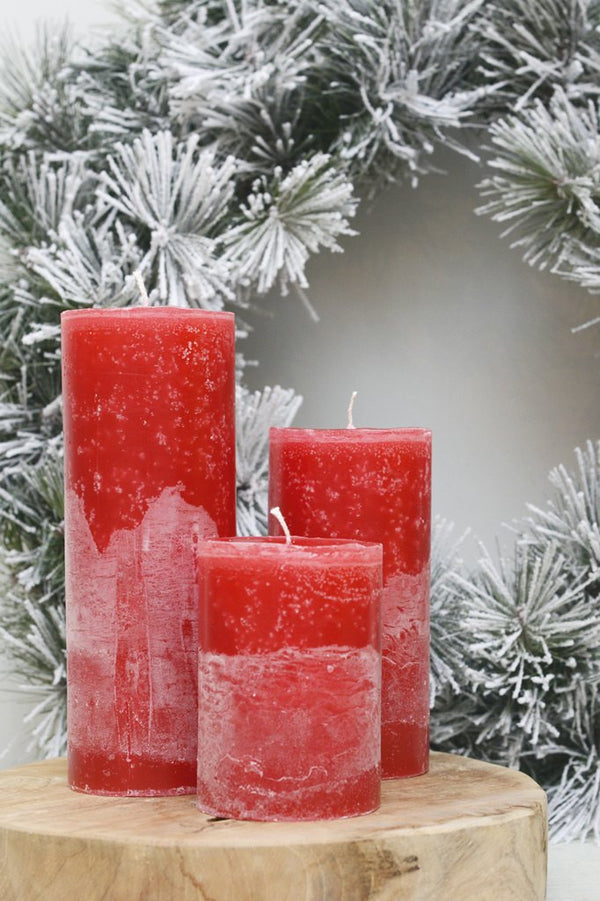 Set of 3 christmas candles pictured in front of a wreath