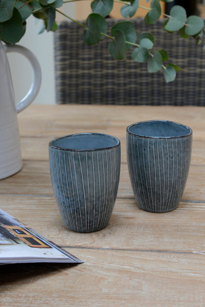 two blue nordic sea mugs without handles