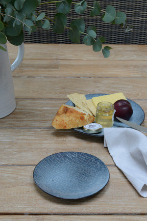 Nordic sea side plate in lifestyle shot next to cheese plate