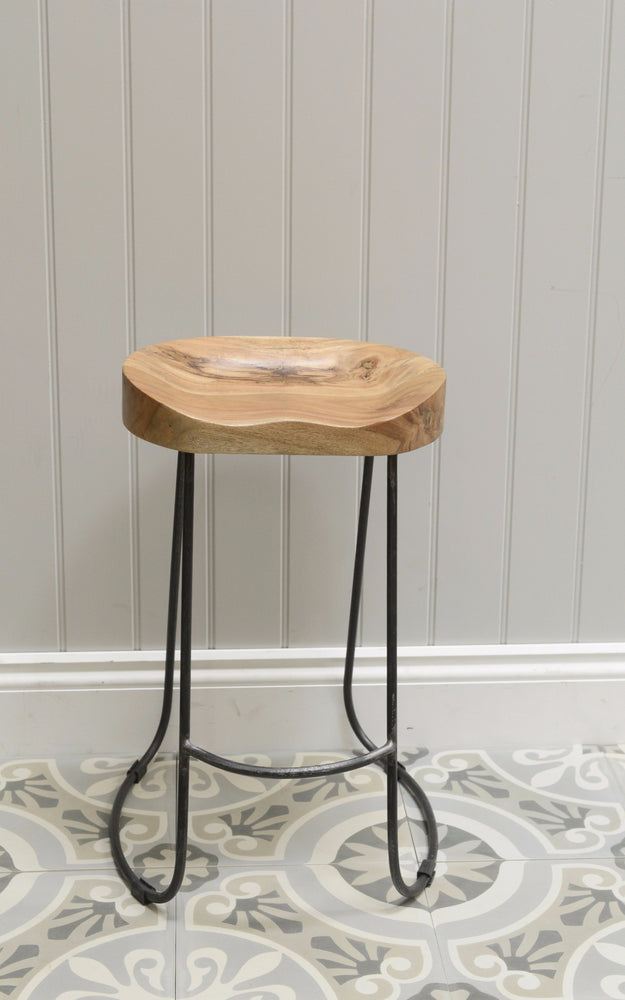 Wooden low Oslo stool shot against grey background