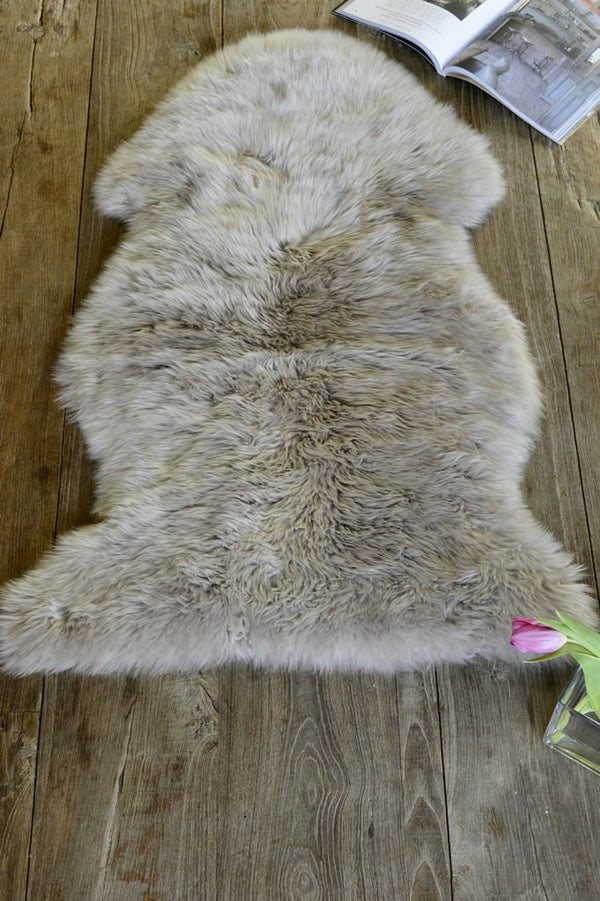 Soft neutral sheepskin rug on the floor