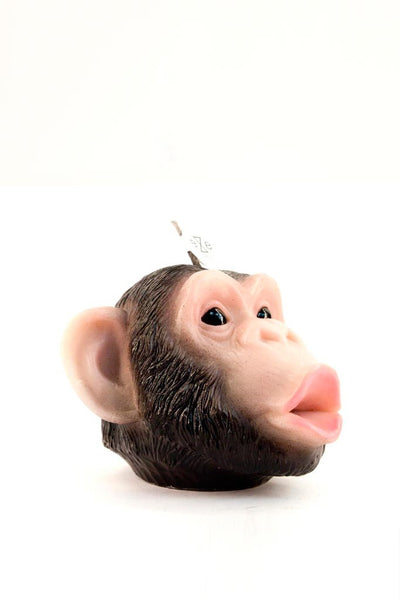 A side profile shot of our hand painted chimpanzee candle.