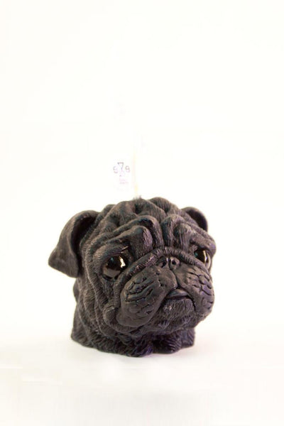 An angled shot of our scented brown wax pug candle