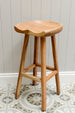 Wooden Koben stool shot against grey background