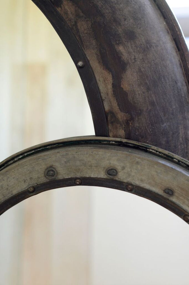 A close up shot showing the metal detail on the hammered iron frame of the mirror