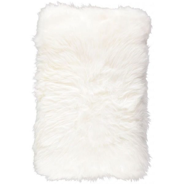 Studio shot of our rectangular New Zealand sheepskin cushion in ivory colour