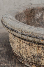 Close up of the aged wooden body of the shallow tea pickers bowl.