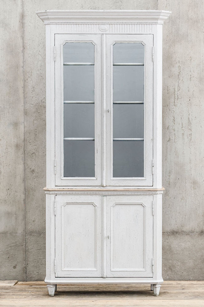 Front view of the lightly distressed Van Thiel Louis Phillippe Armoire Deux Corps cabinet.