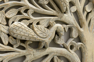 A close up shot of the intricate detail on the hand carved wooden tree