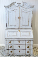 A solid oak white Gustavian bureau with a worn, rustic look.