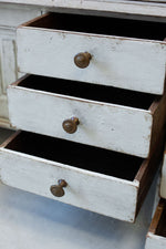 Painted white oak drawers of the Gustavian Bureau, open at Cotswold Grey