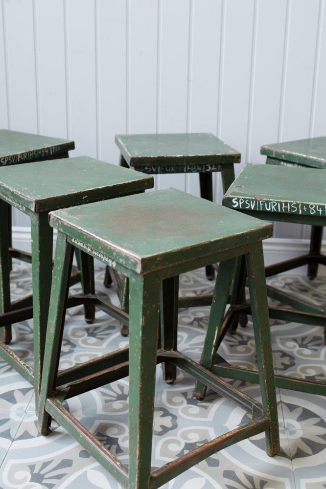 Collection of green Indian Railway Stools at Cotswold Grey.