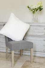 Polar white cushion on grey dining chair