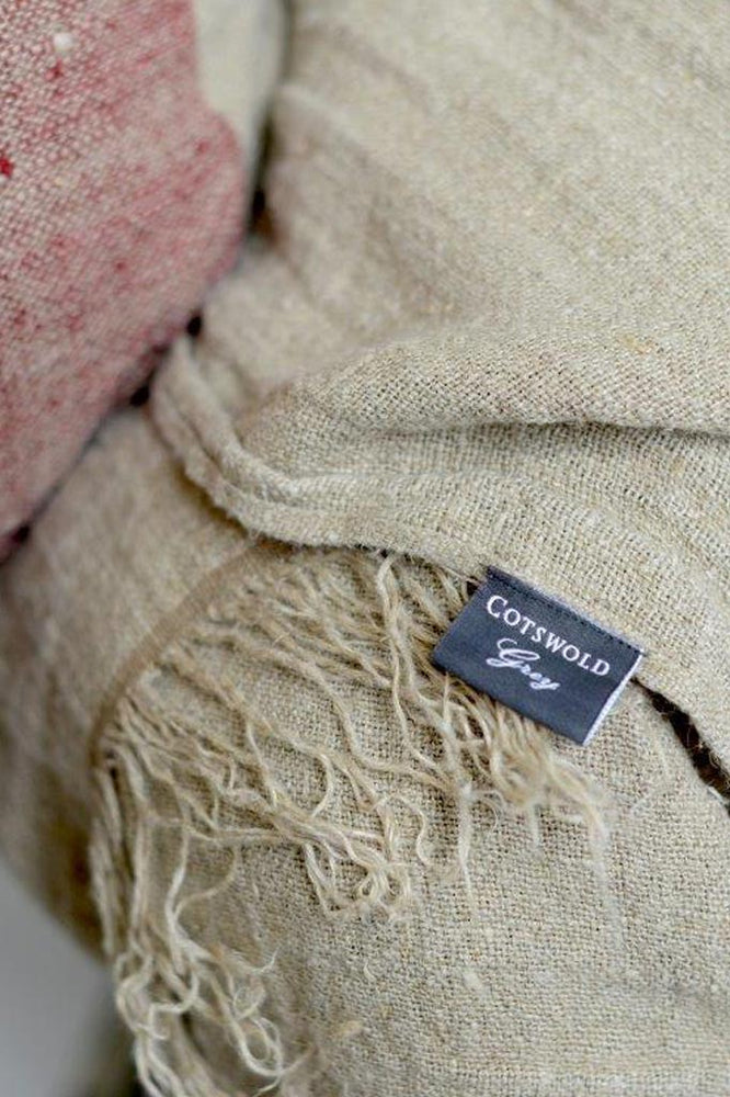 Cotswold Grey label on the Hali Red linen throw.