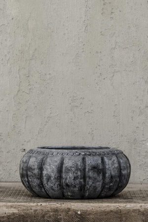 Load image into Gallery viewer, Carved stone bowl, against concrete wall.