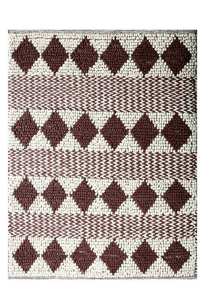 Hand woven rug showing diamond pattern.