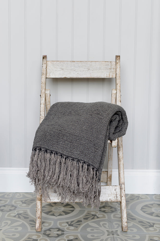 Kabuli charcoal linen throw on chair.