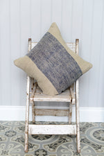 Front of the Cotswold Grey Hali Blue cushion pictured onto of a indian chair
