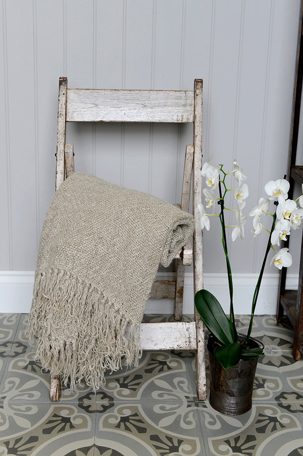 The Israna linen throw draped over an indian folding deck chair