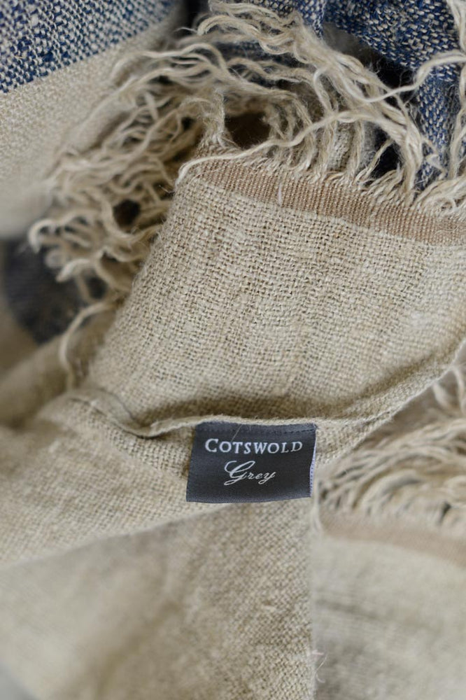 The Cotswold Grey label of the Hali linen throw.
