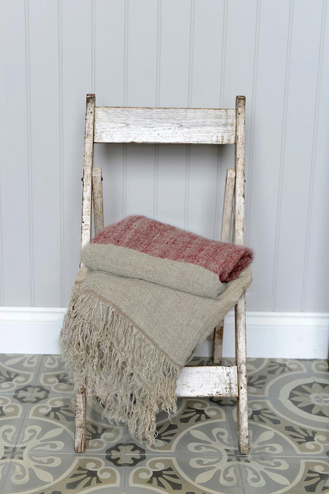 Hali Red Throw Pictured on top of an Indian Chair