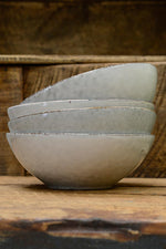 A stack of Nordic Sand cereal bowl, by Broste at Cotswold Grey.