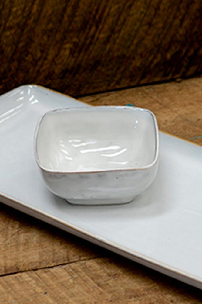 Broste's Nordic Sand small square bowl, on matching platter.