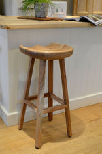 Wooden Koben stool shot from front against grey background