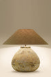 Bellimo rustic looking brown/grey stone lamp with a weathered look