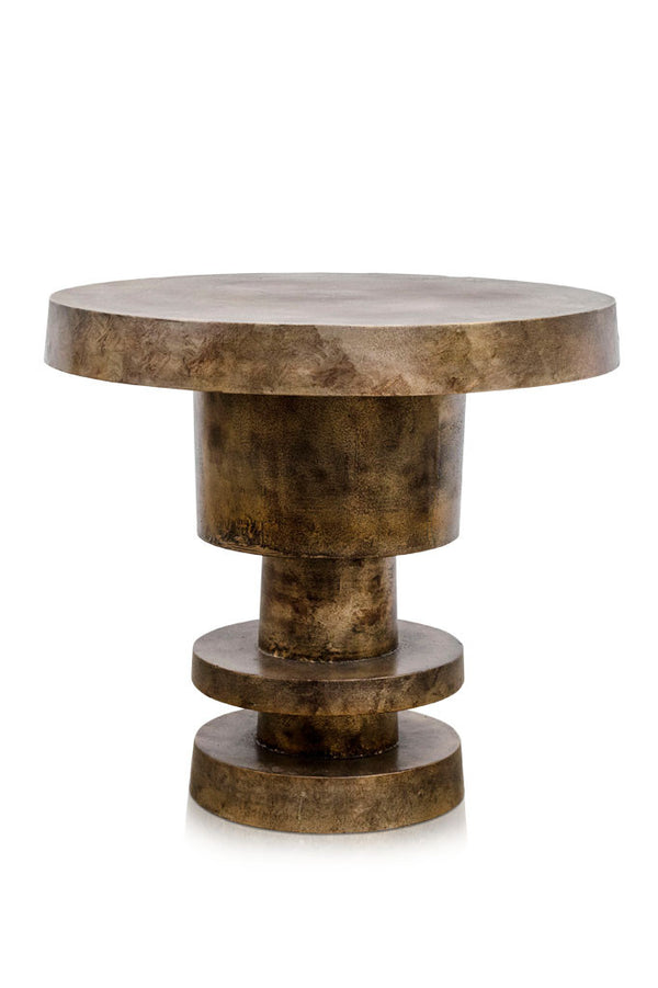 An aged gold high chunky Spindle Table with a warm patina