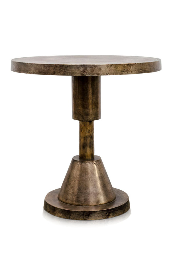 Studio shot of the tall thin Spindle table in aged gold colour with a warm patina