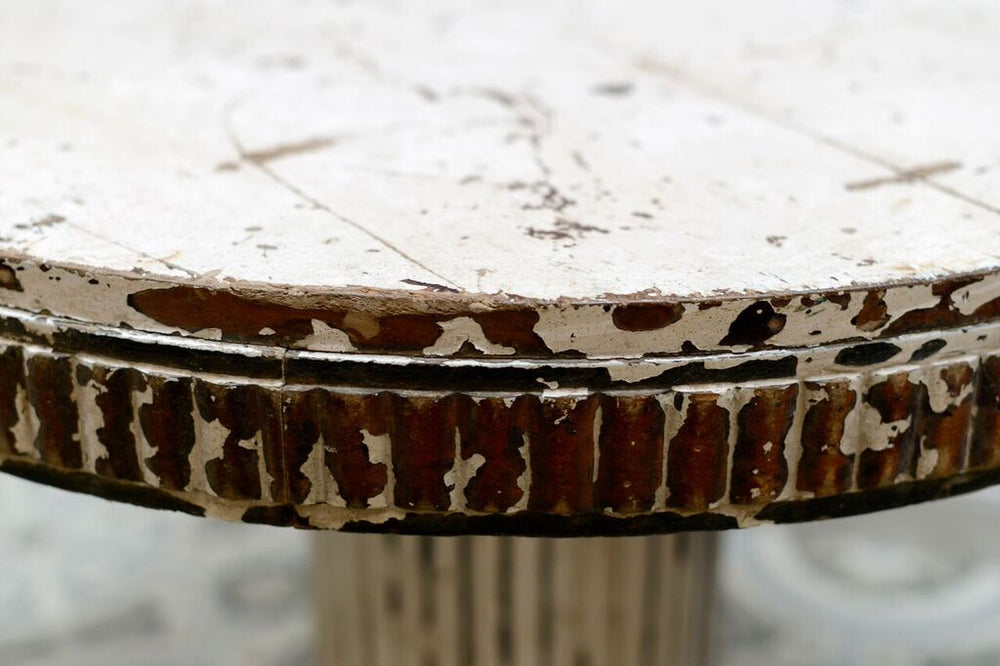 A close up shot showing the distressed vintage side of the coffee table
