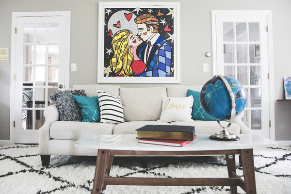 We love how our painting and pillows complement each other with the white couch and globe!