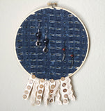 Distressed Denim Earring Hanger And Wall Decor With Fringe Accent