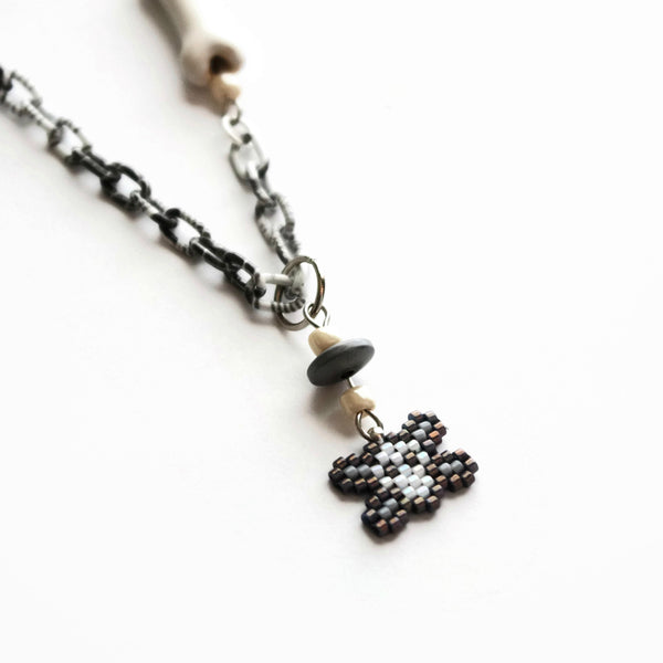 Mini Skull And Cross Bones Statement Necklace With Ceramic Bone Accent
