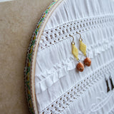Decorative White Fabric Earring Hanger In Use 2