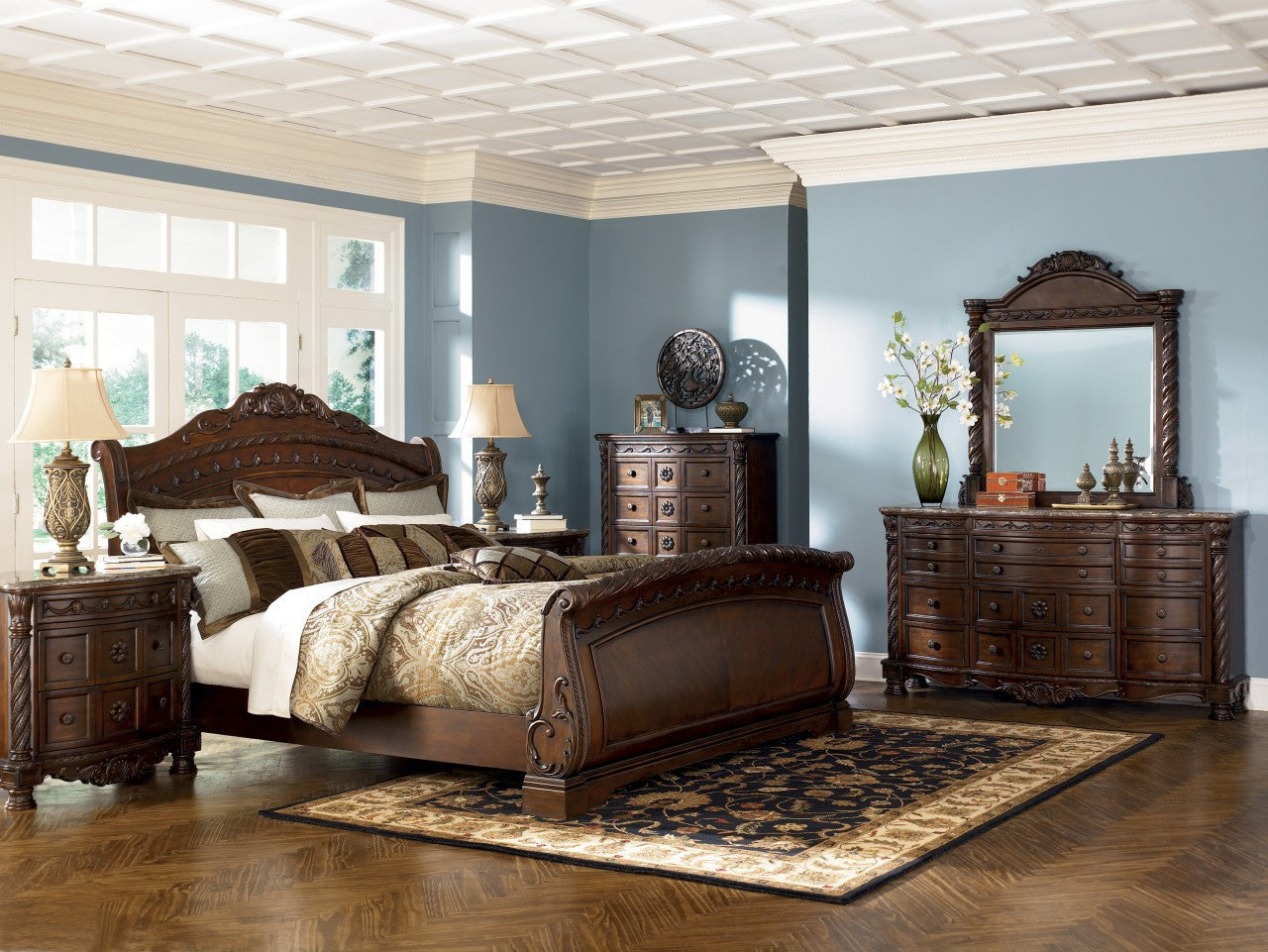 Picture of: North Shore Sleigh King Bedroom Set By Ashley Furniture My Furniture Place