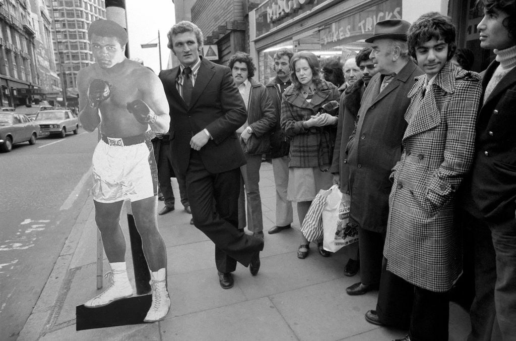 Detail of Joe Bugner with a life size cut out of Mohammad Ali by Staff