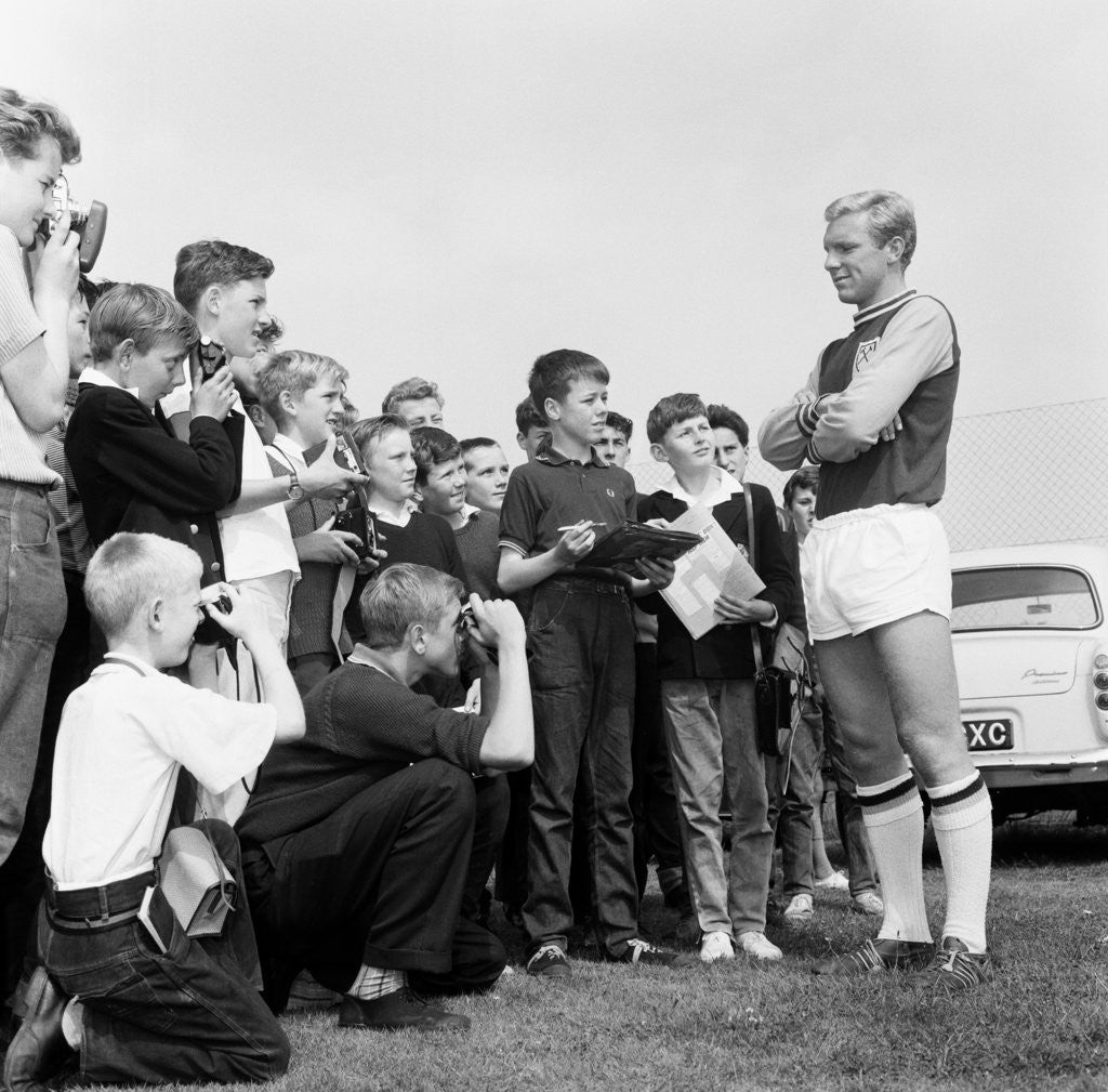 Detail of Bobby Moore poses for young fans by Monte Fresco