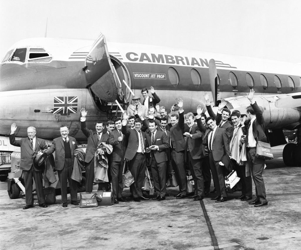 Detail of Everton team members wave before their plane departs from Speke airport by Terry Mealy