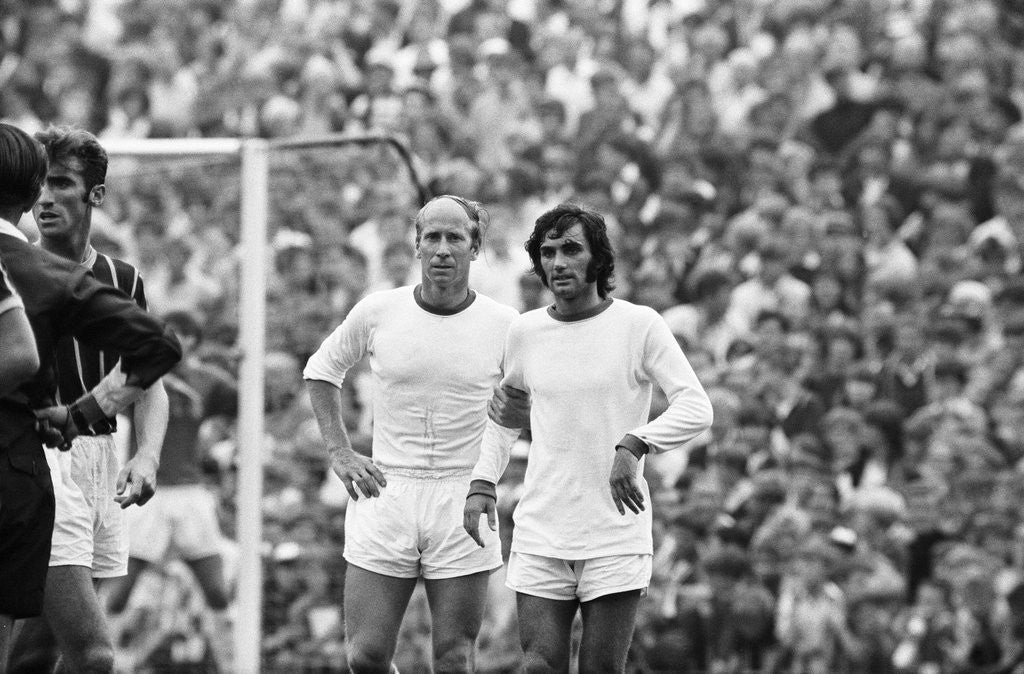 Detail of Bobby Charlton and George Best await a free kick 1969 by Monte Fresco