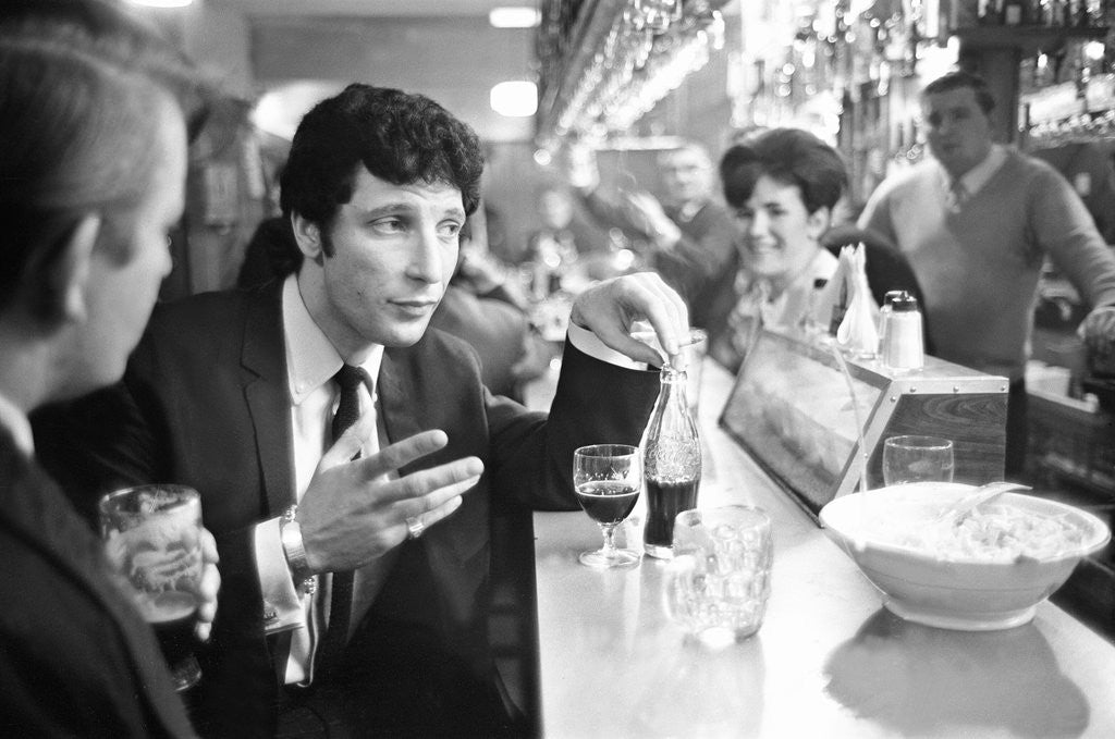 Detail of Tom Jones, enjoys a drink, 22nd February 1965. by Davies